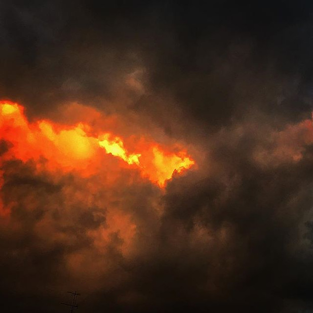 just like a flame thrower shot onto the heavy clouds (sunset sketch)
