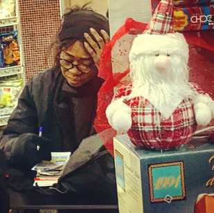 black mama gambling to satisfy Santa's expectations (another urbanstyle portrait)