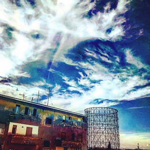 clouds like brush strokes on a colorful post-industrial horizon (streetsketch)