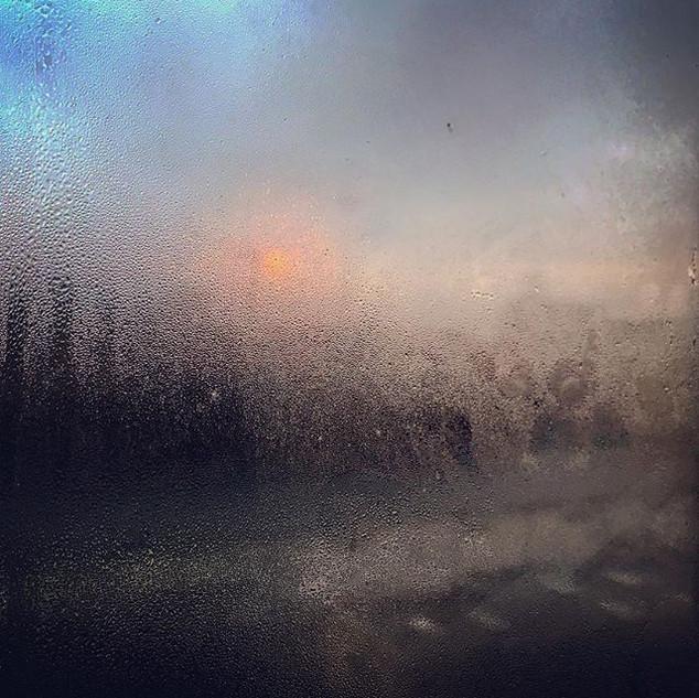 sunrise behind a steamy window