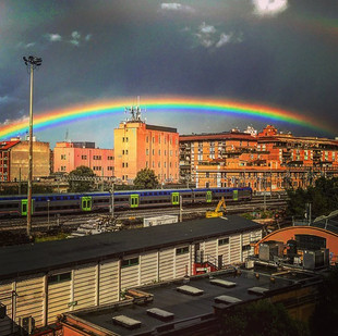 astonishing perfection of nature's graft with civilization_ a rainbow (streetsketch)
