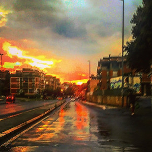 reflections and phosphorescences on the wet road at sunset (a vision)