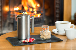Relax by the fire with a coffee