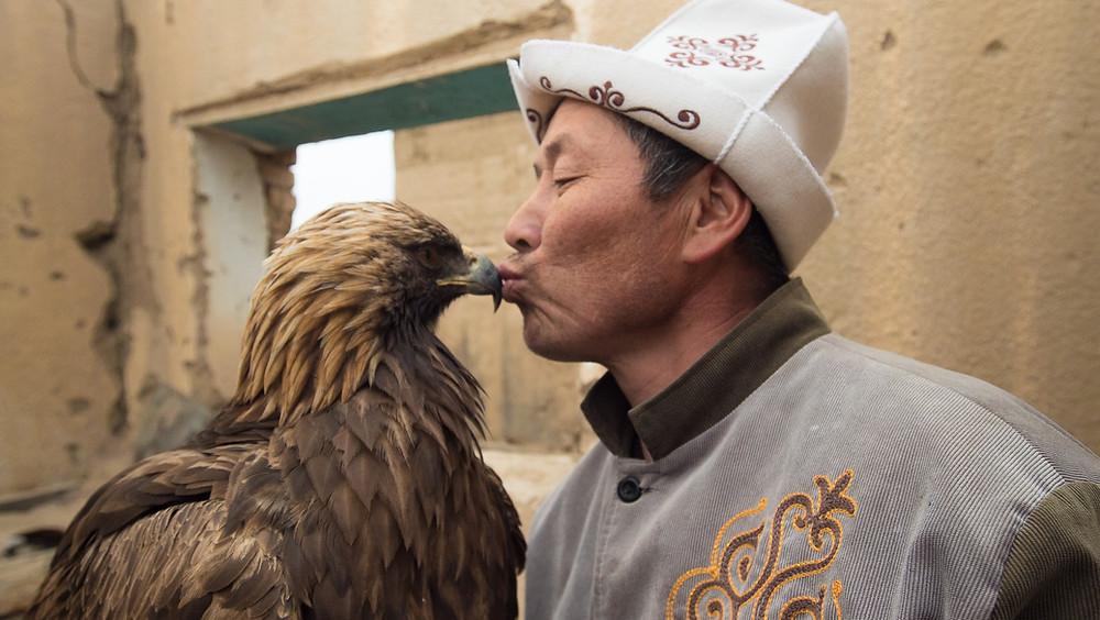 Eagle Hunter Talgar kissing his eagle Tumara