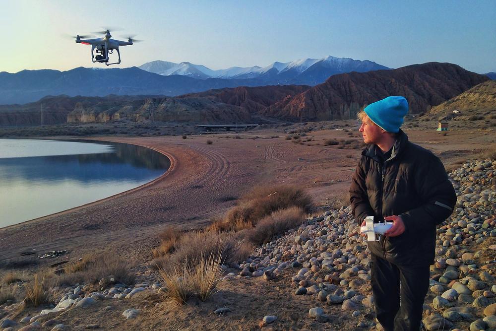 Sebastian filming with his DJI Phantom drone in Kyrgyzstan