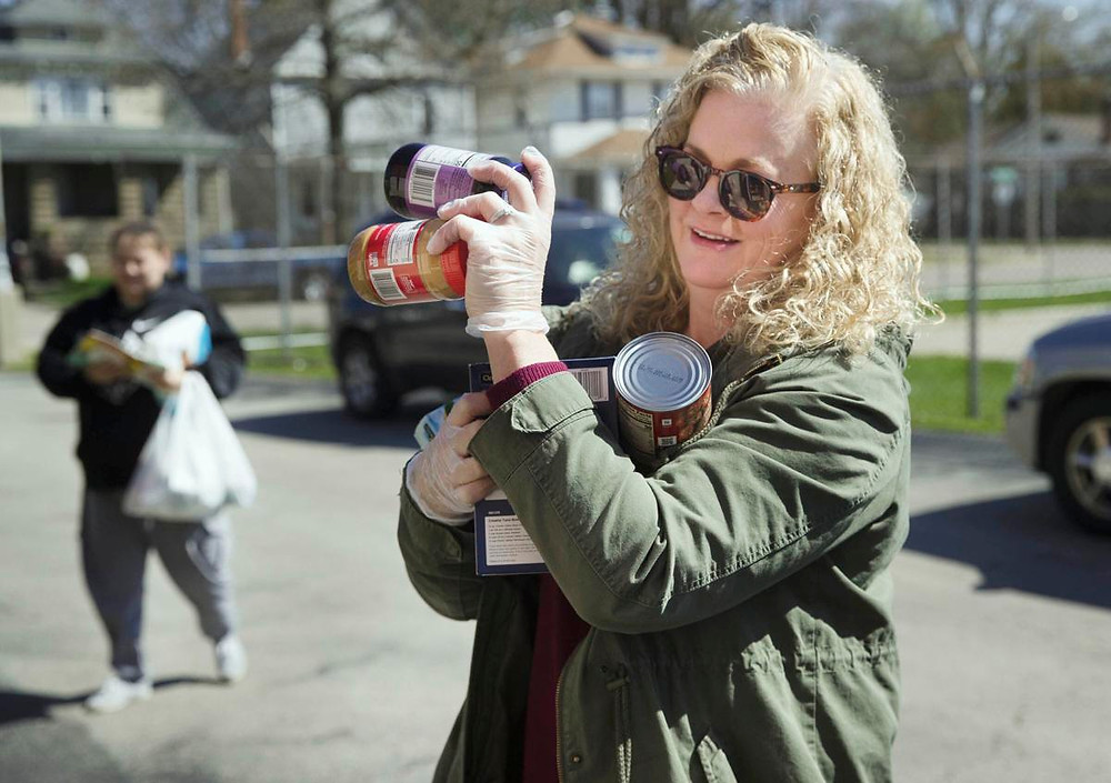 Lynn Ehmen carries supplies to the micropantry at Lanphier High School in Springfield TED SCHURTER