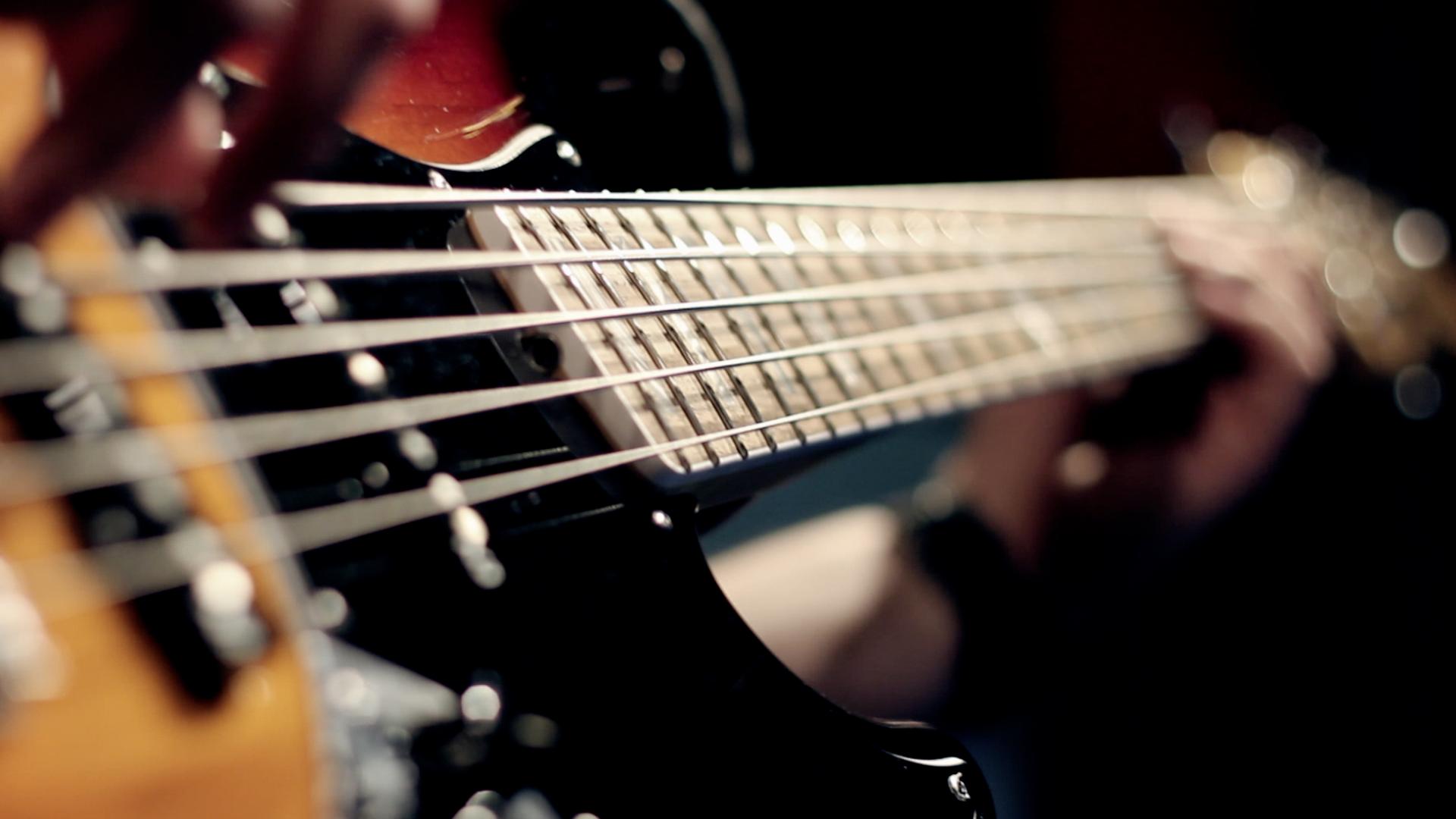 bass hands close shot.png