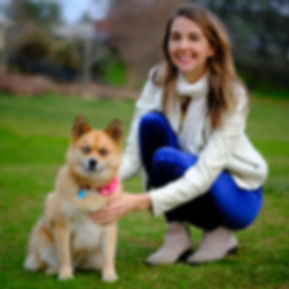 Dr. Heather Bird with Pomsky dog Coconut Kisses at Auburn Dog Park
