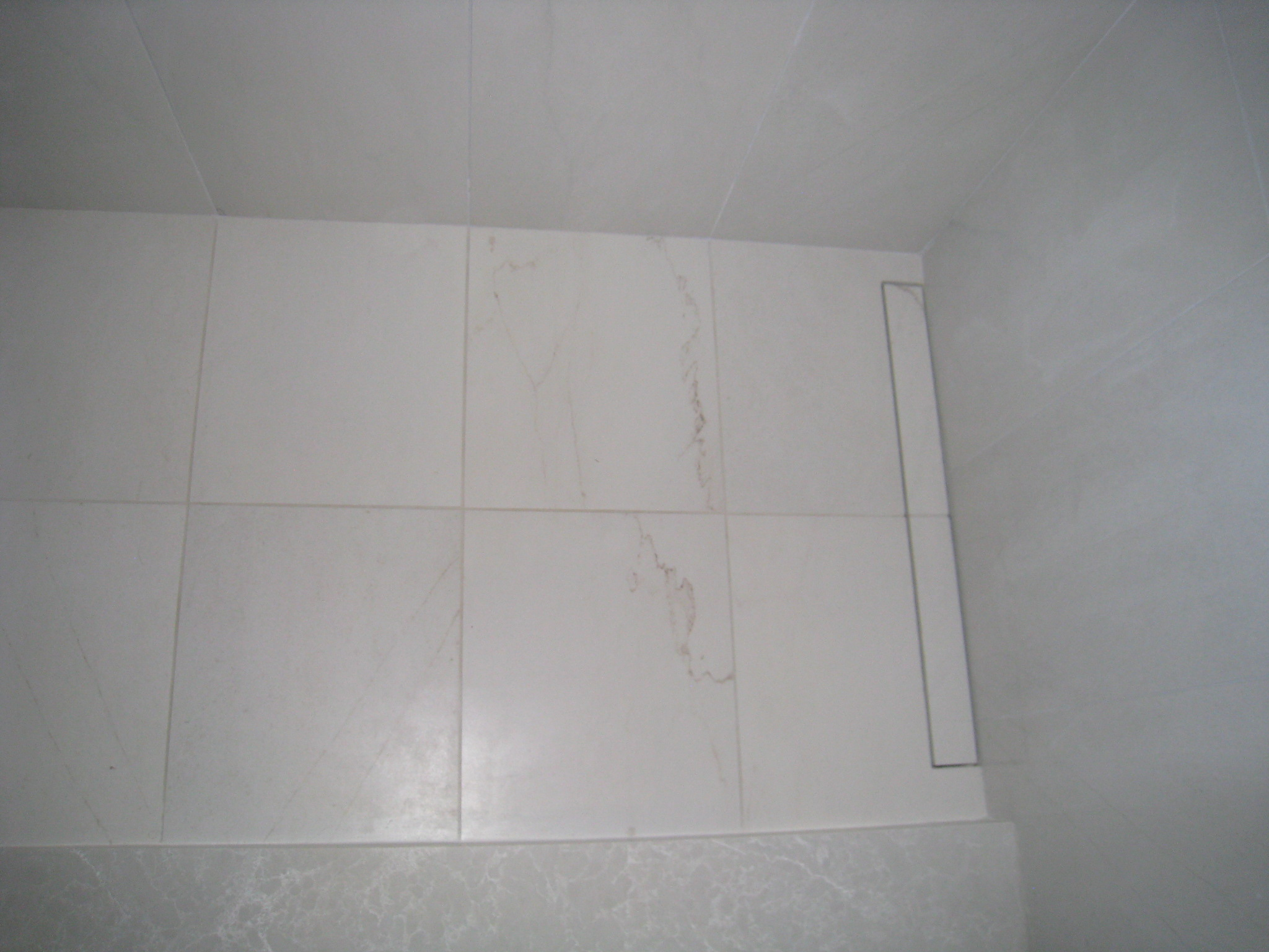 Invisible tillable shower drain