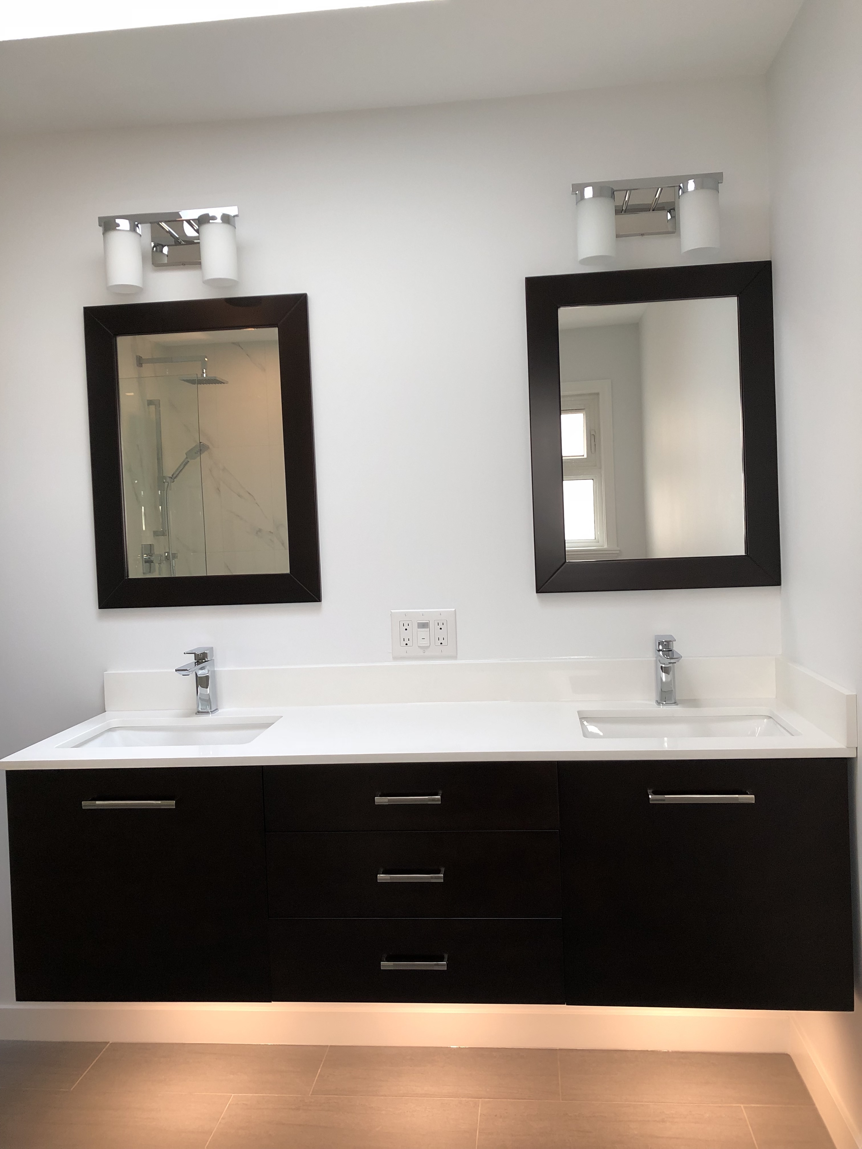 Vanity with motion sensor under cabinet lights