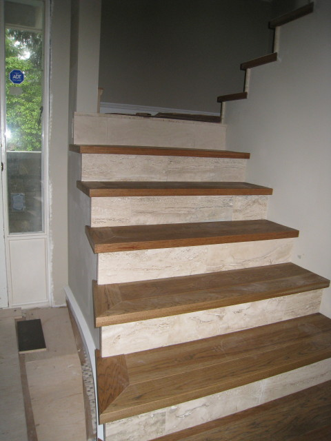 Natural wood and travertine stairs