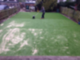 artificial lawn fake turf garden preparation with kiln dried sand compacting