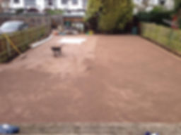 screed garden surface to prepare garden for fake grass artificial turf lawn installation