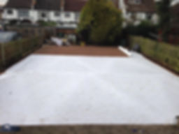 geo textile membrane covers the garden in preparation for fake grass artificial lawn turf installation