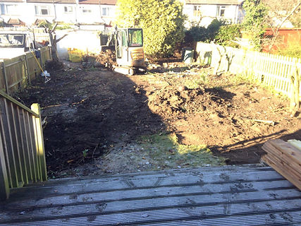 lawn turf soil grass being digged up from a rear garden to prepare for artificial turf lawn grass installation