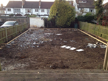 garden preparaton for fake grass artificial lawn turf timber frame installation in gardn
