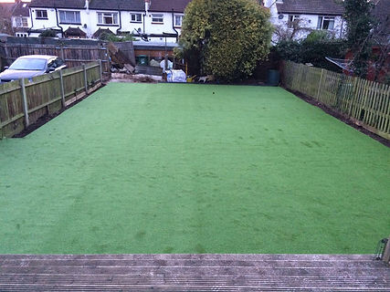 laying artificial turf fake lawn to garden
