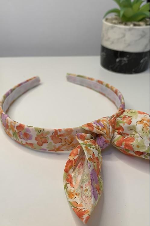 Orange floral headband with bow