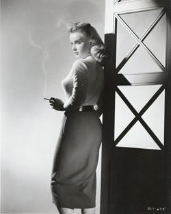 anne-francis-smoking-film-noir-sweater-girl.jpg