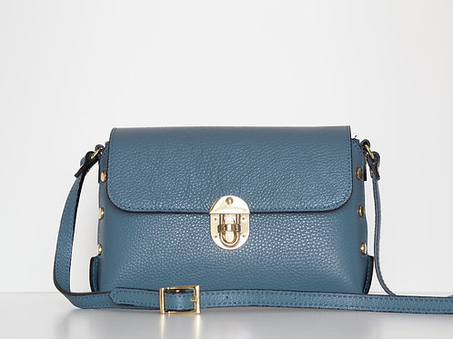 Studded leather shoulder bag in denim blue front view with strap