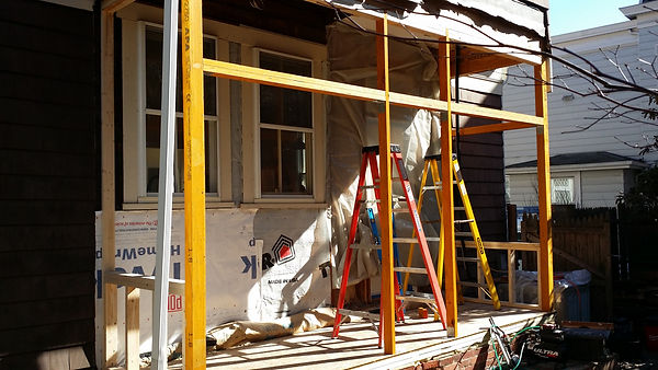 remodeling project in framing phase showing framing for new windows and doors