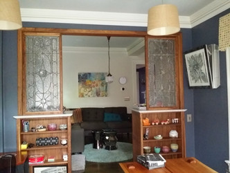 room divider cabinetry in walnut with marble tops and leaded glass