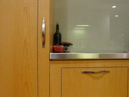 detail of custom cabinets of maple veneer with inlay