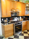 white oak custom cabinetry with retro formica counter