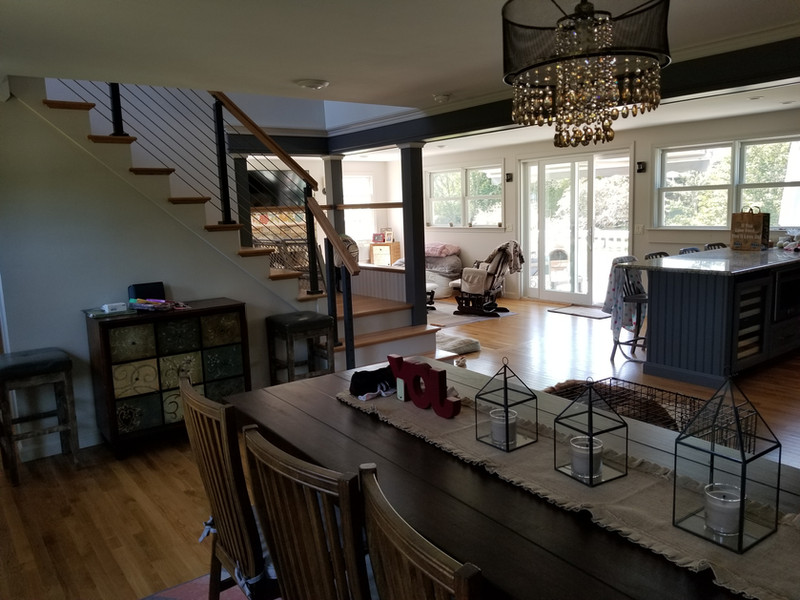 view from dining room showing stair rail and new doors and windows after renovation