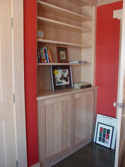 Built-in cabinetry with bookcase in pickled hemlock