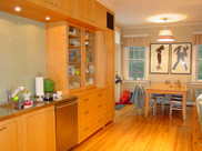Custom kitchen cabinetry with maple veneer and inlay