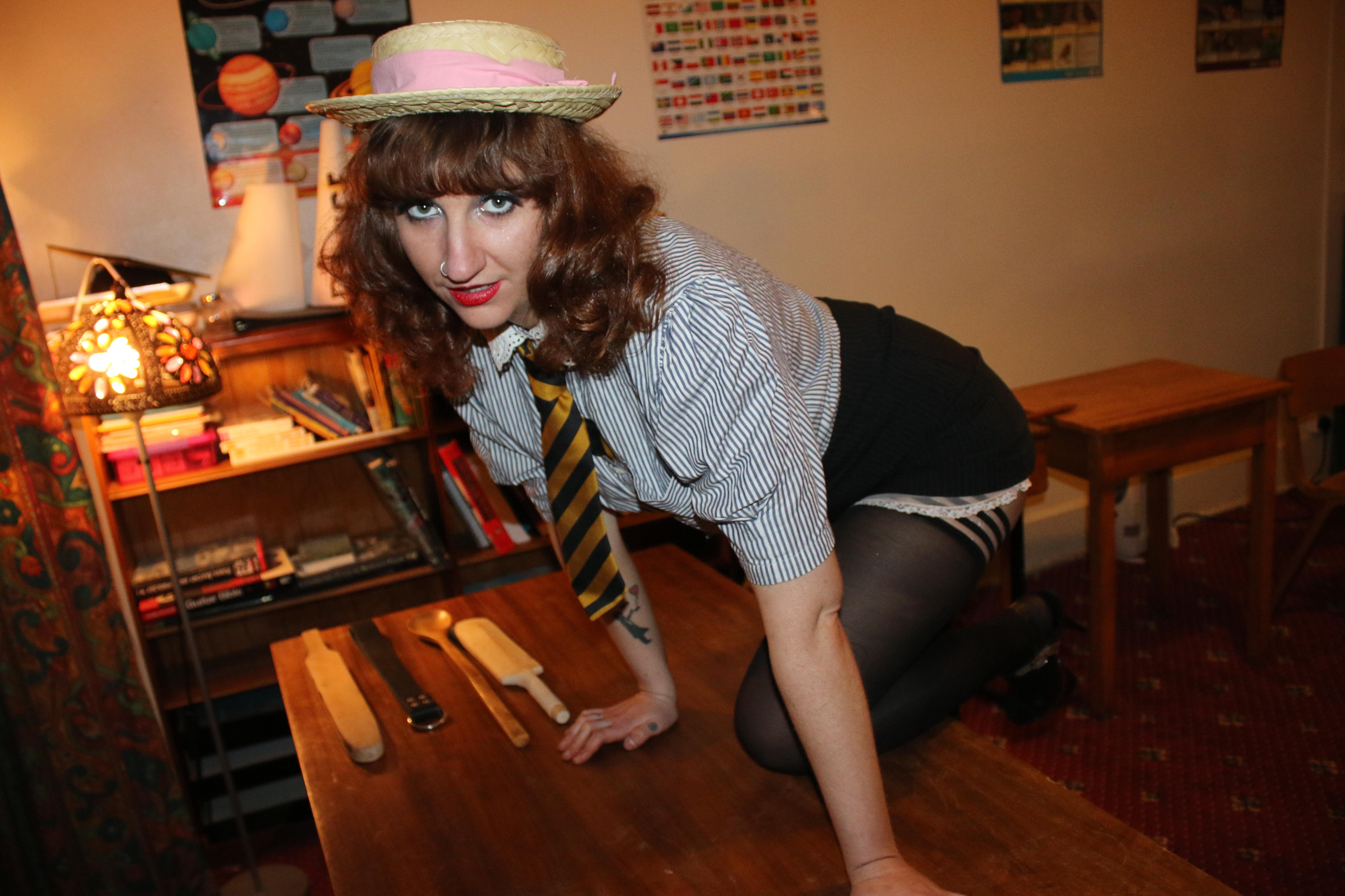 naughty girl climbing on the desk