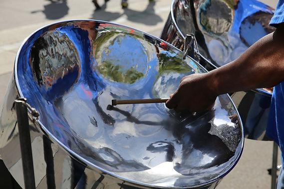 Steel pan drum player with sticks.jpg