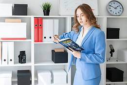 Woman in suit reading.png