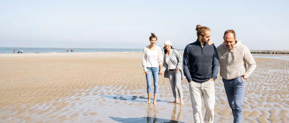 men-talking-while-walking-with-women-sta