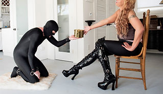 Slave presenting tribute to Mistress