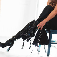 thigh-high leather dominatrix boots