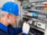male-electrician-examining-fusebox-pictu