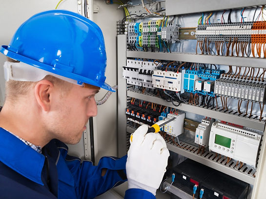 male-electrician-examining-fusebox-pictu