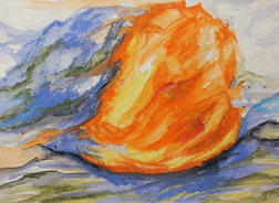 An abstract firey image of orange against Blue of distant mountain view