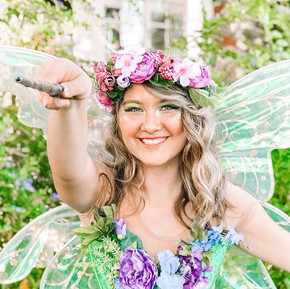 Spring fairies help the flower bloom.