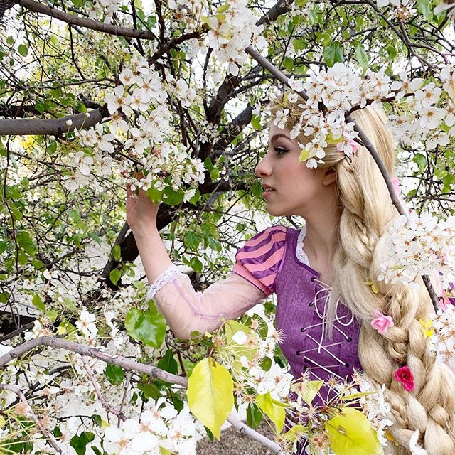 Princess Rapunzel among the flowering trees