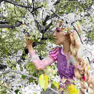 Princess Rapunzel among the flowering trees