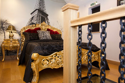 Opulent gold and red king size bed