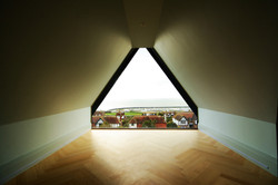 Contemporary gable window in traditional house