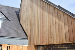 Timber cladding at roof junction