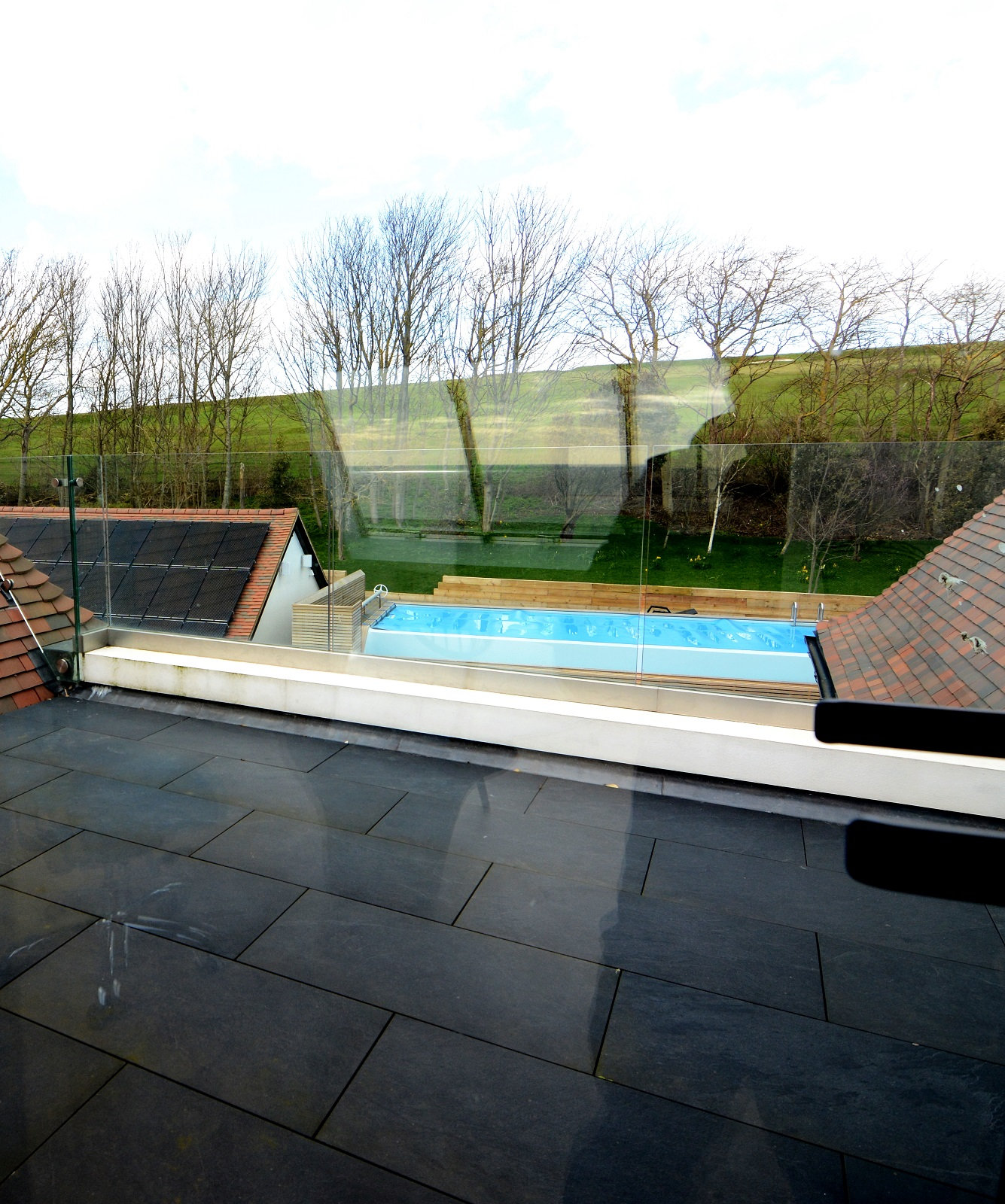 Glazed roof terrace looking over landscape