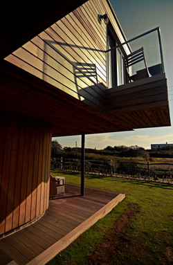 Glass balcony projects into the landscape