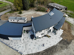 The new patio curves withe the form of the house