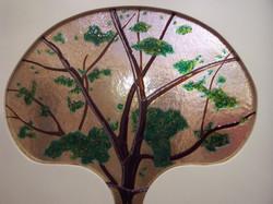 tree decorated door glass